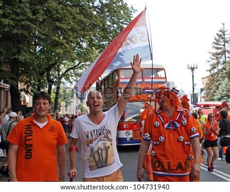 KHARKIV, UKRAINE - JUNE 9: Netherlands fans at Kharkov streets before UEFA EURO 2012 football match vs. Denmark national team, June 9, 2012 in Kharkiv, Ukraine - stock photo