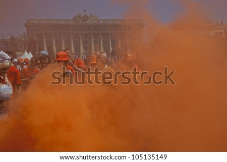 KHARKIV, UKRAINE  JUNE 13: Orange smoke in the Dutch fan zone before a UEFA Euro 2012 football match between Germany and Netherlands on June 13, 2012 in Kharkiv, Ukraine