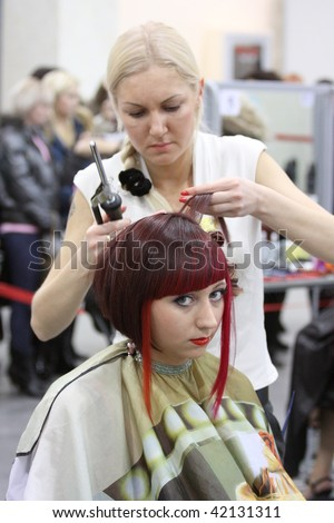 KHARKIV, UKRAINE - NOVEMBER 26: Hairdressing contest within national fashion industry exhibition MIRROR OF FASHION-KHARKOV-2009, November 26, 2009 in Kharkov, Ukraine