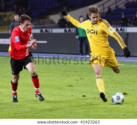 KHARKIV, UKRAINE - NOVEMBER 21: Marko Devich(R) breaks through defense during FC Metallist (Kharkov) - FC Zarya (Lugansk) (2:0) soccer match, November 21, 2009 in Kharkov, Ukraine