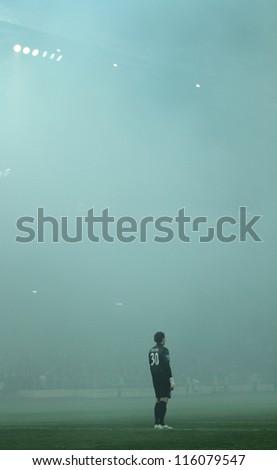 KHARKIV, UKRAINE - OCTOBER 7: FC Shakhtar Donetsk GK Andriy Pyatov in dense smoke during football match vs FC Metalist Kharkiv, October 7, 2012 in Kharkov, Ukraine