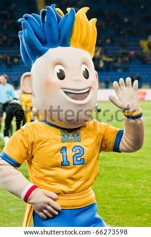 "KHARKOV, UA - NOVEMBER 27:  Presentation of the symbols of the World Cup ""Euro 2010"" before the football match at the stadium ""Metalist"" in Kharkov NOVEMBER 27, 2010 in Kharkov, Ukraine - stock photo"