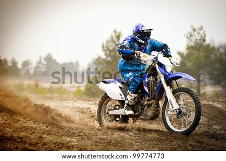 KHARKOV, UKRAINE - APRIL 7: An unidentified rider participates in the rally to enduro motocross fans on April 7, 2012 in Kharkov, Ukraine.
