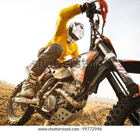 KHARKOV, UKRAINE - APRIL 7: Yuriy Dyemkin rider participates in the rally to enduro motocross fans on April 7, 2012 in Kharkov, Ukraine.