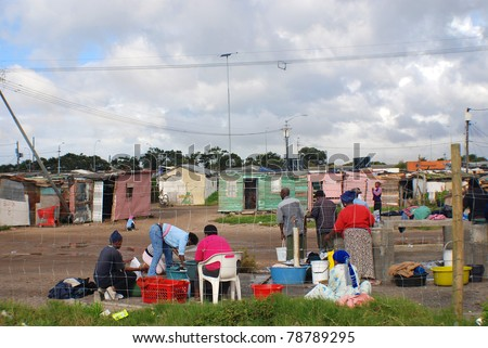KHAYELITSHA, CAPE TOWN - MAY 22 : A unidentified group of person wash their clothes in Khayelitsha township, the name is Xhosa for New Home on May 22, 2007, Cape Town, South Africa