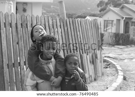 KHAYELITSHA, CAPE TOWN - MAY 22 : A unidentified group of young boys play in a street of Khayelitsha township, on May 22, 2007, Cape Town, South Africa