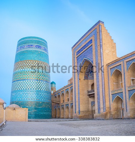 KHIVA, UZBEKISTAN, MAY 3, 2015: The unique and unfinished Kalta Minor Minaret, covered with bright blue tiles, became the symbol of the town, on May 3 in Khiva.