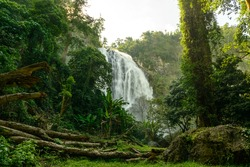 Khlong Lan Waterfall is a large waterfall with water flowing down from the cliff, 100 meters high, 40 meters wide, located in Khlong Lan National Park, Kamphaeng Phet, Thailand.