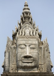 Khmer Architecture with Buddha Face Detail at Entrance Gate to Sangke Pagoda Budhhist Temple in Battambang, Cambodia