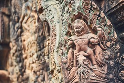 Khmer low relief sculpture in Prasat Banteay Srei Temple. Unesco world heritage site (Siem Reap Province, Cambodia, Asia). World location:  The Angkor complex was the ancient capital of Khmer Empire.