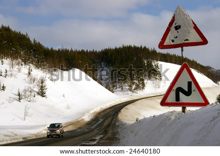"Kholmskiy mouting pass in winter and sign ""Dangerous tumblings"".The Island Sakhalin."