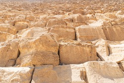 Khufu pyramid in Giza stone block texture, close up of Great Pyramid stone cube in Cairo, Egypt