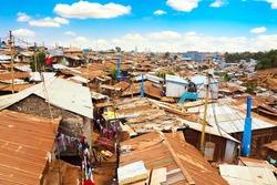 Kibera slum in Nairobi during sunny day with blue sky and clouds. Kibera is the biggest slum in Africa. Slums in Nairobi, Kenya.