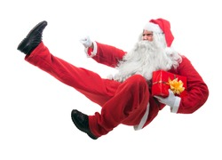 Kickboxing Santa Claus flying isolated on white background. Aggressive Santa Claus jumps with feet kick. Fighting Santa Claus with a gift. Attack Santa Claus with a kick jump on white background.