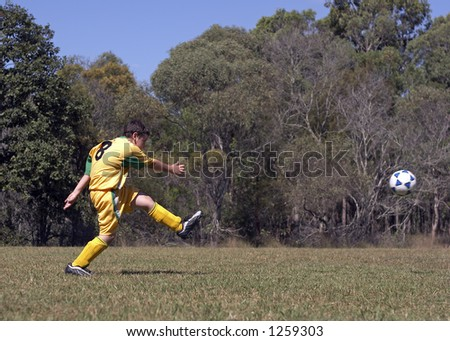 kicking soccer ball. stock photo : Kicking soccerball on field