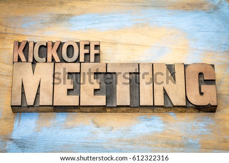 Kickoff meeting word abstract in letterpress wood type printing blocks against grunge wooden surface #612322316
