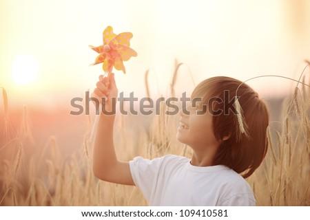 Kid at wheat field