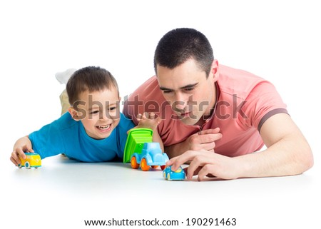 Kid boy and father play with car toys