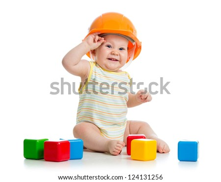 kid boy playing with building blocks toy