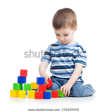 kid boy playing with colorful building blocks or bricks