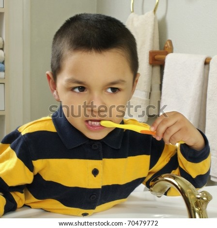 Kid brushing teeth in front of a mirror, Hispanic, four years old