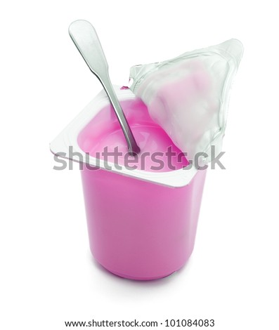 Kid cherry yogurt with spoon isolated on white background