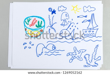 Kid drawings set of different sea animals and elements - child outline scribble of sailboat on waves, fish in wild life and aquarium, starfish and jellyfish isolated on white background.