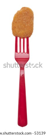 Kid Friendly Chicken Nuggets on Bright Plastic Forks for a Fun Snack. - stock photo