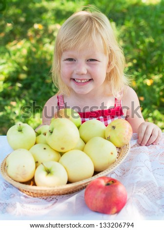 Kid girl and apples