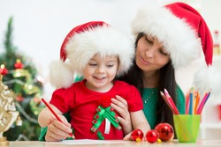 kid girl and her mother writing letter to Santa