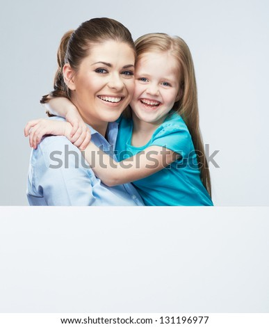 Kid girl and mother isolated against gray background . Child portrait in adult business style .