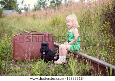 Kid girl, dog and trunk