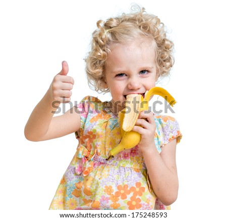 kid girl eating banana and showing ok sign