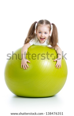 Kid girl having fun with  gymnastic ball isolated