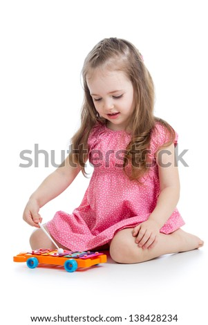 kid girl playing musical toy