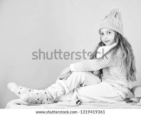 Kid girl wear cute knitted fashionable hat and comfortable cozy clothes. Girl long hair relaxing pink background. Winter fashion for children. Kid smiling fashion model. Winter fashion concept. #1319419361