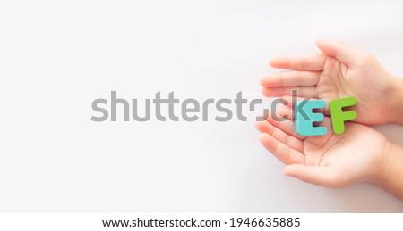kid hand showing EF skill on white banner background.Child development.EF - Executive Functions.Healthcare, self esteem kid, child, childhood, Executive Functions skill on kid.self control.school. Stock photo ©