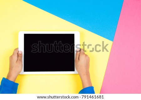 Kid hands with tablet computer on colorful background #791461681
