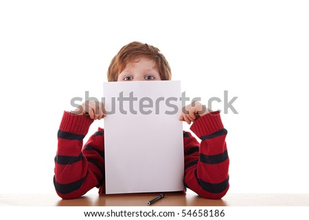kid holding a white sheet of paper in his hand; isolated on the white background. Studio shot.