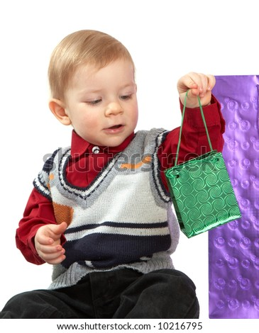 kid holds a green package