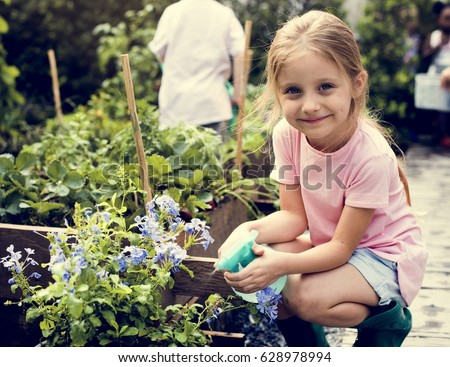 Kid in a garden experience and idea #628978994