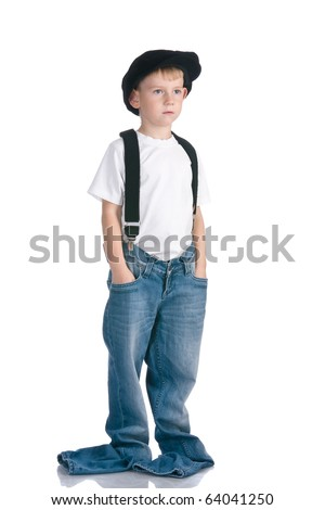 Kid in cap and too long jeans