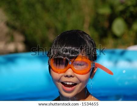 Kid in garden pool