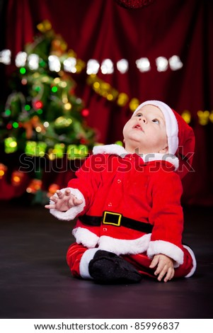 Kid in Santa costume looking up