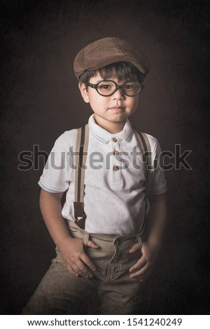 kid in vintage clothes with suspender fine art portrait