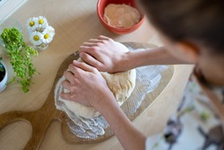 Kid is making, easy to prepare and healthy, home made irish soda bread - during stay at home