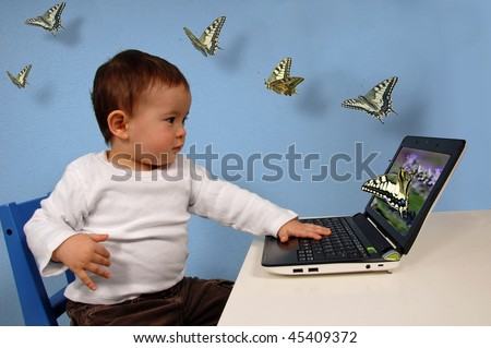Kid looking at computer with butterflies fluttering out of the screen.