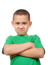 kid  looking down scowling angry, arms crossed