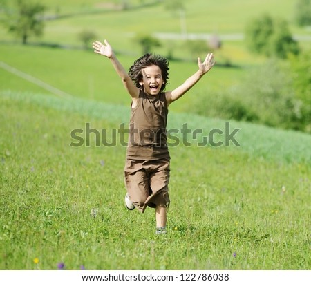 Kid on meadow - stock photo