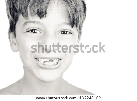 Kid or child or boy showing his missing milk teeth isolated on white background. Black and white.